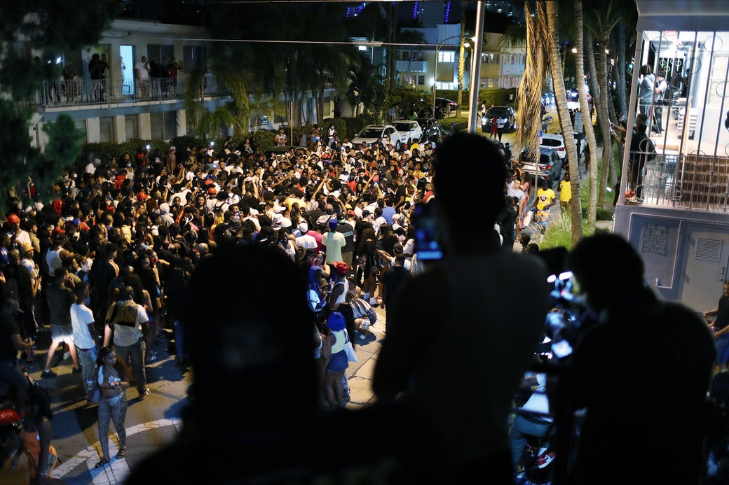 A crowded street at night